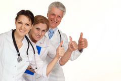 Three smiling Caucasian doctor standing Stock Images