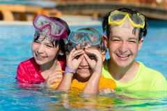 Three Smiling Children in Pool Stock Photography