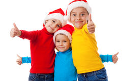 Three smiling children with thumb up sign Stock Image