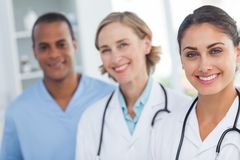 Three smiling doctors looking at the camera Royalty Free Stock Images