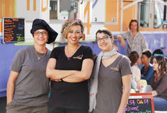 Three smiling female food truck entrepreneurs Royalty Free Stock Photography