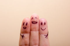 Three smiling fingers that are very happy to be Royalty Free Stock Image