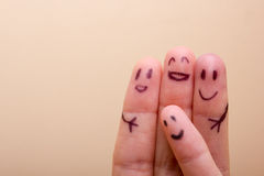 Three smiling fingers that are very happy to be friends Royalty Free Stock Photos