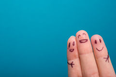 Three smiling fingers that are very happy to be friends Stock Image