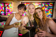 Three smiling friend having glass of champagne Stock Photos