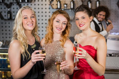 Three smiling friend having glass of champagne Stock Photography