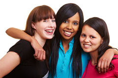 Three smiling friends stock image