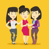 Three smiling friends looking at mobile phone. Royalty Free Stock Image