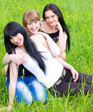 Three smiling girl-friends Stock Photography
