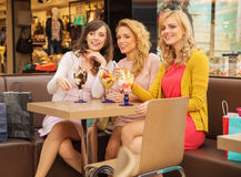 Three smiling girlfriends having the break time Royalty Free Stock Images