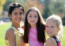 Three smiling girls stock photography