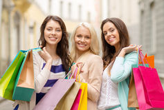 Three smiling girls with shopping bags in ctiy Royalty Free Stock Image