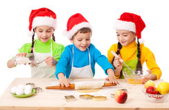 Three smiling kids with Christmas cooking Royalty Free Stock Images