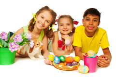 Three smiling kids together with Eastern eggs Royalty Free Stock Image