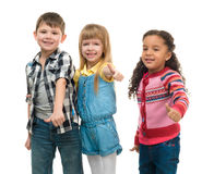 Three smiling little children standing together Royalty Free Stock Photo