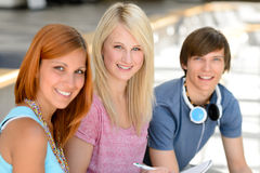 Three smiling student friends looking at camera Stock Photography