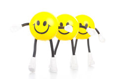 Three smiling toy little men Stock Photo
