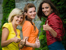 Three smiling women. Three smiling caucasian women showing thumbs-up Royalty Free Stock Photo