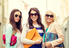 Three smiling women with bags in the city Royalty Free Stock Image