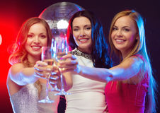 Three smiling women with champagne glasses Royalty Free Stock Photo