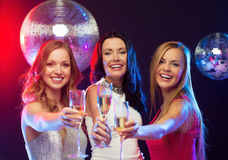 Three smiling women with champagne glasses Royalty Free Stock Image