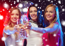 Three smiling women with champagne glasses Royalty Free Stock Images