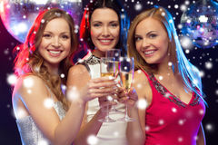 Three smiling women with champagne glasses Stock Image