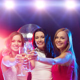Three smiling women with champagne glasses Stock Photography