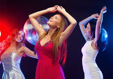 Three smiling women dancing in the club Royalty Free Stock Photos