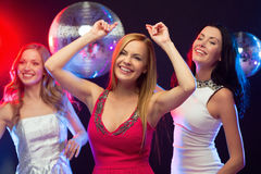 Three smiling women dancing in the club Royalty Free Stock Image