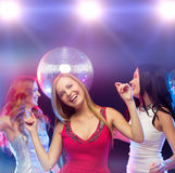 Three smiling women dancing in the club Stock Photography