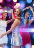 Three smiling women dancing in the club Royalty Free Stock Images