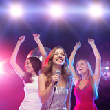 Three smiling women dancing in the club Royalty Free Stock Photo