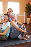 Three smiling women in gym Stock Photography