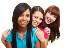 Three smiling women in a row stock photography