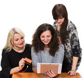 Three smiling women with tablet pc Royalty Free Stock Photos