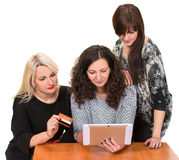 Three smiling women with tablet pc. And credit card Royalty Free Stock Photo