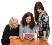 Three smiling women. With tablet pc and credit card Stock Photo