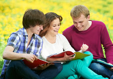 Three smiling young students outdoors Royalty Free Stock Photography