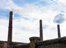 Three smoke stacks of the industrial plant Royalty Free Stock Images