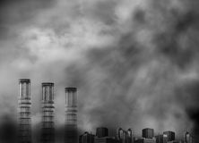 Three Smoke Stacks with Pollution Smoke. Three smoke stags have pollution smoke coming out of the tops and there is a lot of smoke surrounding them in black Royalty Free Stock Image