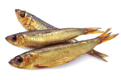 Three smoked fish. On white background royalty free stock photos