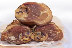 Three Smoked ham hock. On paper in butcher shop stock images
