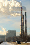 Three smoking chimneys of power plant Royalty Free Stock Images