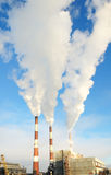 Three smoking chimneys of power plant royalty free stock photo
