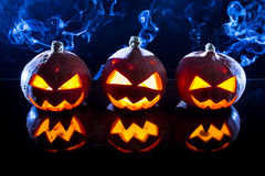 Three smoking pumpkins Stock Image