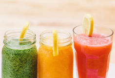 Three smoothies on a white wooden background Royalty Free Stock Photography