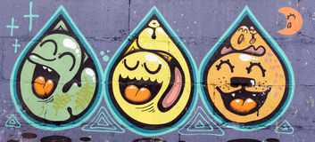 Three Snakes in Drops. Kiev/Ukraine - February 24, 2015 - Graffiti of three snakes or worms closed in water drops, with open mouth and with a big tongue vector illustration