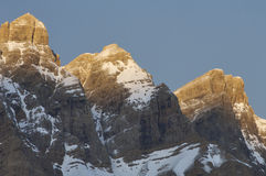 Three snow-capped peaks. Three snowy peaks at sunrise in the Pyrenees, named Cima Capullo , 2567 m., Cima Sin Nombre 2651 m. and El Triptico, 2612 m.; Partacua Royalty Free Stock Photos