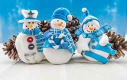 Three Snow Men Ornaments with Pine Cones Stock Images